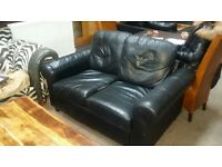 Large one seater leather sofa on swivel base for sale, used condition, only £50!