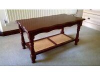 Dark Finish Coffee Table with Wicker Shelf