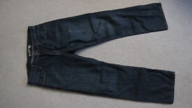 Five pairs of men's jeans for sale. Varying condition.