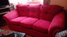 Two Identical Red Sofas