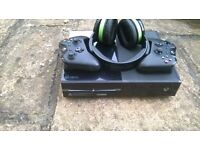 Xbox one with two official controls and battery packs. Also amazing afterglow headset