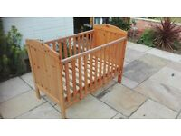 Cot with sliding side.