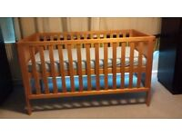 Solid pine cot bed suitable from birth to age 4 years.
