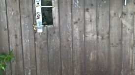 Wooden sheeted metal gates