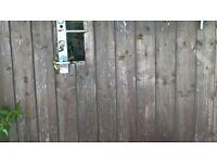 Wooden sheeted metal gates