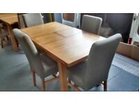 OAK extending dining table with 4 grey chairsb