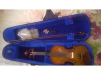 full size violin in excellent condition with antique german violin bow...