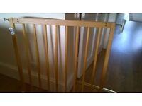 Wooden stair or door safety gate.