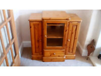 Ducal music centre with pullout DVD storage racks with centre cupboard with glass door