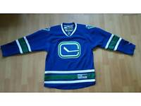 Brand new Reebok Vancouver Canucks Jersey. Size M.