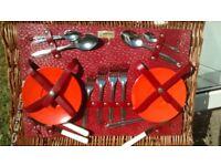 Vintage melaware picnic set in wicker basket