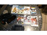 Sony PSP charger and games