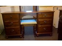 Solid and heavy dressing table with a stool