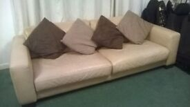 Contemporary Sofa leather. Good quality. Can seat 4 people.