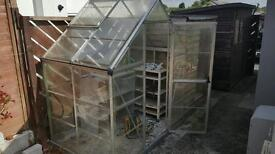 Greenhouse with plastic safety glass