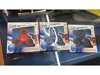 Finger fidgets in 3 different colours