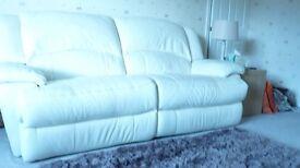 Two Cream leather sofas.