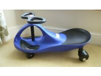 Childs wiggle Gyro siton car. Colour BLUE. NEW.