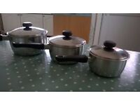 3 stacking stainless steel saucepans