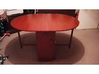 Butterfly Folding Dining Compact Wheeled Table With Storage - Mahogany Finish