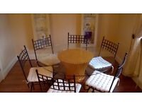 Circular Glass Dining Table and 6 chairs