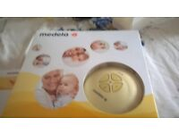 Medala Swing Breast Pump includes extra Bottles