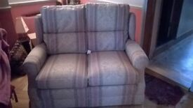 Pretty little two-seater sofa - rarely used, still got flame-retardant label