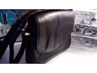 Gorgeously smooth with beautiful shine, soft black leather handbag