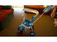 childs stroller and pedal bike