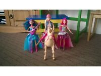 Barbie Saddle'n'Ride Doll and Horse and Two Barbie Rock'n'Royal Dolls.