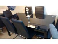 Designer Black Glass Extending dining table & 6 Modern Black Leather & Chrome Chairs UNUSED