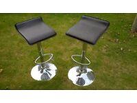 Two swivel bar stools