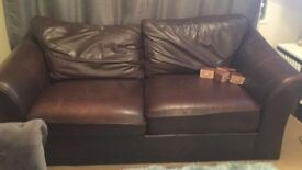 2seater leather brown sofa .approx 190 cm length. Worn ..needs tlc.. but comfortable.. heavy too