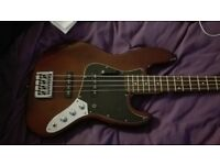 Squier by fender jazz bass guitar, walnut color