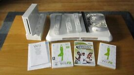 Wii Console + Wii Fit + 3 Controllers + 2 Nun chucks + Virtual Tennis + Wii Fit.