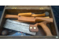 A Wooden box of vintage tools