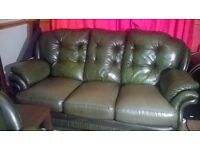 Dark green leather 2 and 3 seater sofa. In good condition