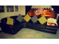 Black leather DFS corner sofa and single chair
