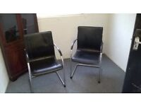 Two leather office chairs