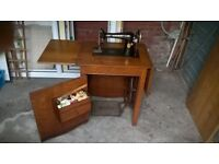 singer sewing machine in oak cabinet, good condition