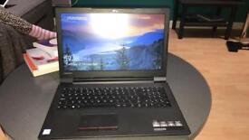 Black Lenovo laptop and hipoint case