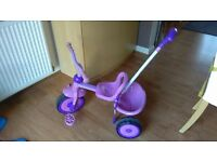 LIKE NEW child's pink trike with parent handle