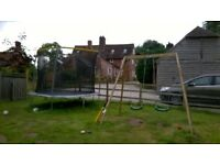 large trampoline with net and double swing