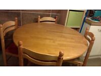 Round Table honey pine 4 upholstered chairs