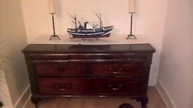 £40 buys you a lovely old chest of drawers with a beautiful dark lustre