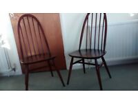 Pair of Ercol Quaker Chairs for sale in dark finish.