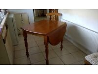 Solid wood kitchen table and 2 matching chairs (with Cushions)