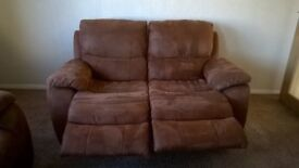 Two and three seater leather sofas with recliners.