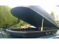 car roof top box, large luggage carrier capacity, rear opening, solid