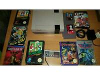 Nintendo nes console and 9 games